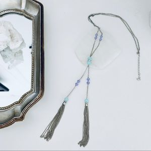 Long glass bead Y necklace with chain tassels.
